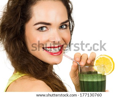 Close-up portrait of a beautiful healthy woman drinking an organic green smoothie. Isolated on white. - stock photo