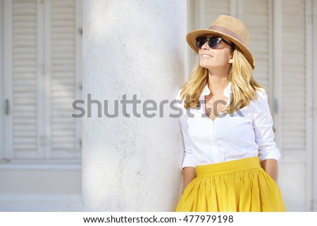 Close-up portrait of a beautiful middle aged lady enjoying a summer day outdoor.