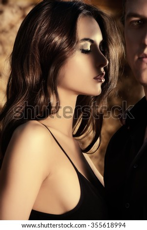 Close-up portrait of a beautiful sexual couple in love. Passion. - stock photo