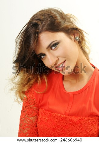 close up portrait of a beautiful smiling caucasian girl with her long hairs in an artistic mess up on White background - stock photo