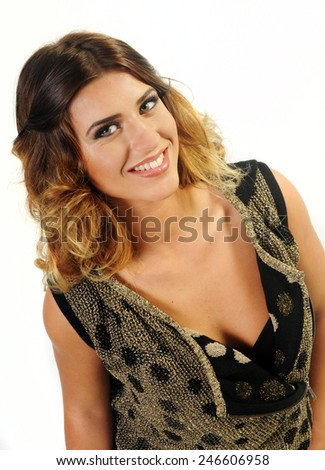 close up portrait of a beautiful smiling caucasian girl with long curly hair wearing Golden vest with black polka dots showing her Young perfect skin isolated on White background - stock photo