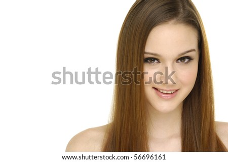 Close-up portrait of a beautiful teenage girl smilling - stock photo