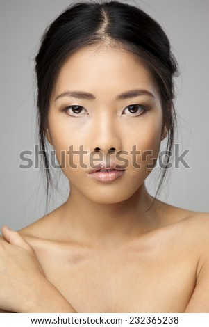 Close-up portrait of a beautiful woman looking at camera. - stock photo