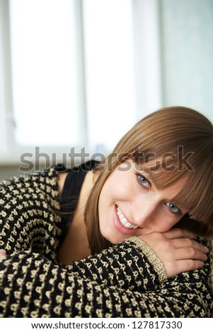 Close up portrait of a beautiful woman smiling - stock photo