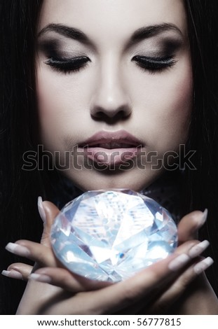 Close-up portrait of a beautiful woman with a diamond - stock photo