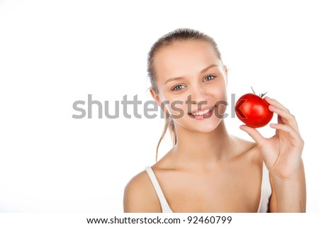 close-up portrait of a beautiful woman with a tomato, juiced tomato in hand, vegetarian food, caucasian attractive girl holding tomato,isolated on white image - stock photo