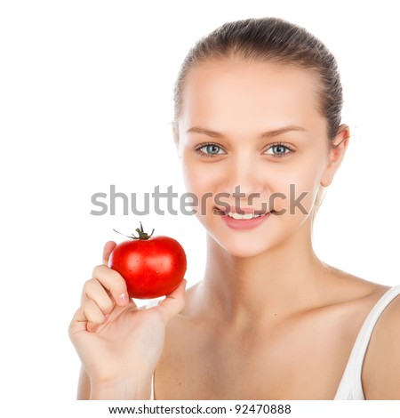 close-up portrait of a beautiful woman with a tomato,vegetarian food, smiled attractive caucasian girl holding tomato near face, woman eating ripe red juiced tomato,isolated on white