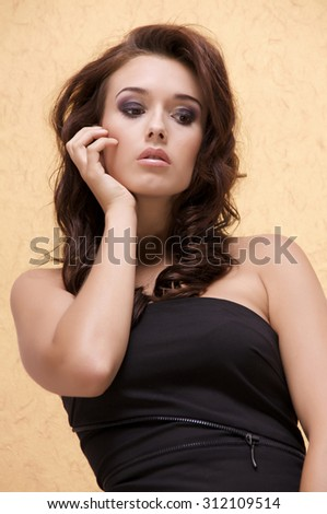 Close up portrait of a beautiful young adult attractive sensuality and sexy pretty brunette woman. Head shot