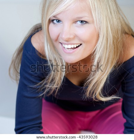close-up portrait of a beautiful young blonde woman - stock photo