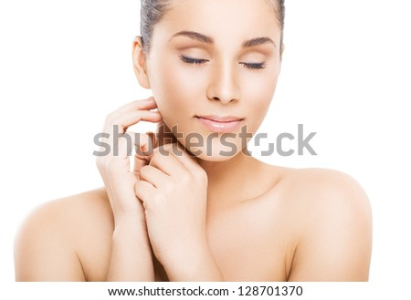 Close-up portrait of a beautiful young woman - stock photo