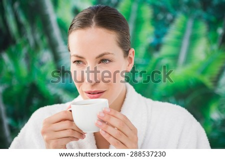 Close up portrait of a beautiful young woman drinking a coffee over white background
