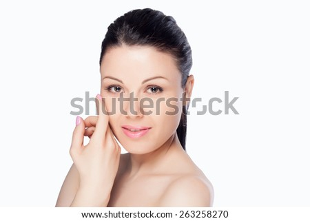 Close-up portrait of a beautiful young woman isolated on white background. Skin care concept. Natural look. Beauty portrait. Spa and health. - stock photo