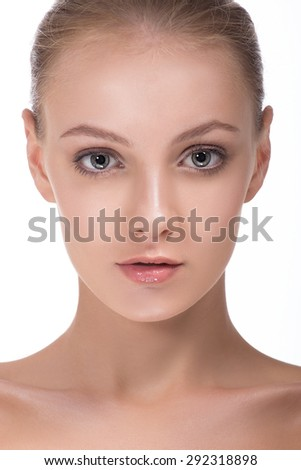 Close-up portrait of a beautiful young woman light blue eyes looking at camera. - stock photo