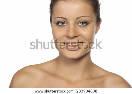 Close-up portrait of a beautiful young woman looking at camera - stock photo