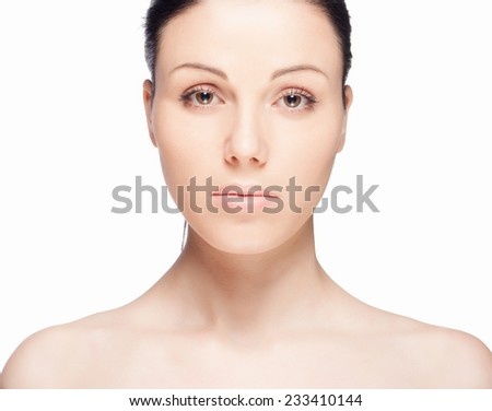 Close-up portrait of a beautiful young woman. Skin care concept. Natural look. Beauty portrait isolated on white background. Spa and health.