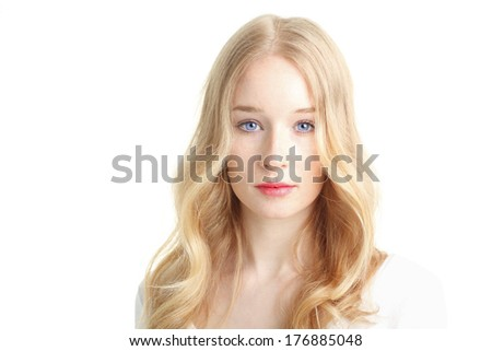 Close-up portrait of a beautiful young woman smiling on white background. - stock photo