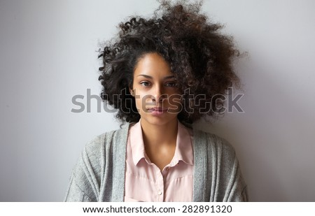Close up portrait of a beautiful young woman with afro hairstyle - stock photo