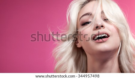Close-up portrait of a beautiful young woman with blond hair - stock photo