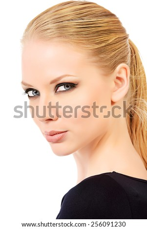 Close-up portrait of a beautiful young woman with smoky eyes make-up wearing black fitting clothing. Beauty, fashion. Body care. Isolated over white. - stock photo