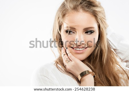 Close-up portrait of a blonde woman with beautiful curly hair and natural makeup - stock photo