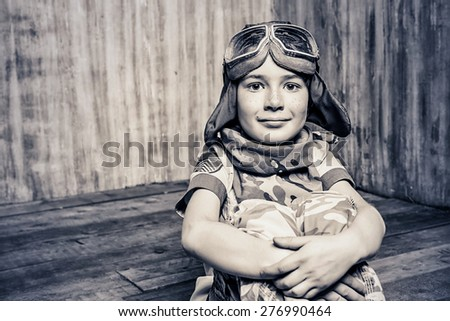 Close-up portrait of a boy who dreams of becoming a pilot. Childhood. Fantasy, imagination. Retro style. - stock photo