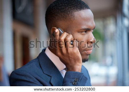 Close up portrait of a businessman calling by mobile phone - stock photo