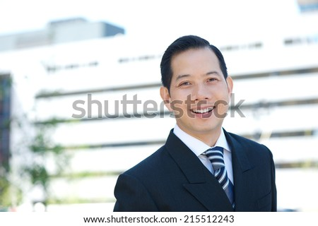 Close up portrait of a businessman in suit smiling