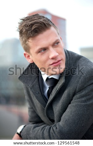 Close up portrait of a businessman outdoors - stock photo