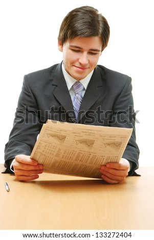 Close-up portrait of a businessman reading newspaper isolated on white background - stock photo