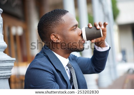 Close up portrait of a businessman relaxing with a cup of coffee during a break - stock photo