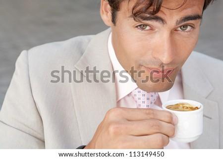 Close up portrait of a businesswoman drinking coffee outdoors. - stock photo