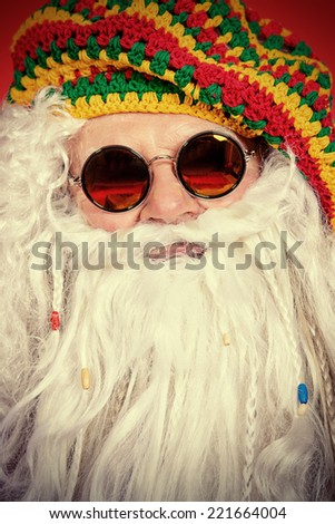 Close-up portrait of a casual Santa Claus hippie. - stock photo