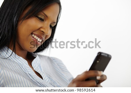 Close up portrait of a charming beautiful young woman reading a text message on mobile phone - stock photo