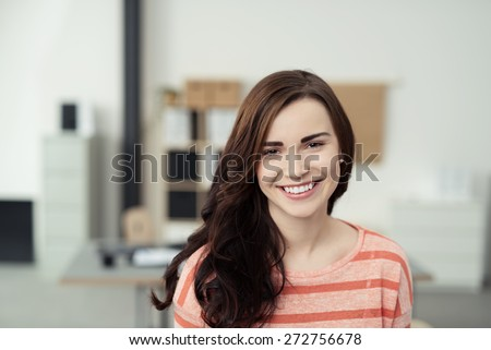 Close up Portrait of a Charming Pretty Long Hair Young Woman Inside the Office Looking at the Camera. - stock photo