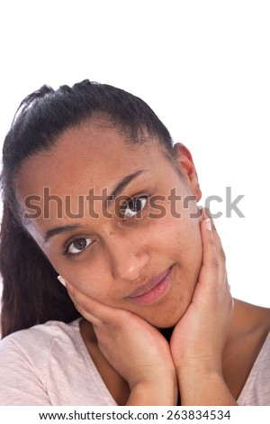 Close up Portrait of a Charming Young Asian Indian Girl with Both Hands on her Face and Looking at the Camera. Isolated on White Background. - stock photo