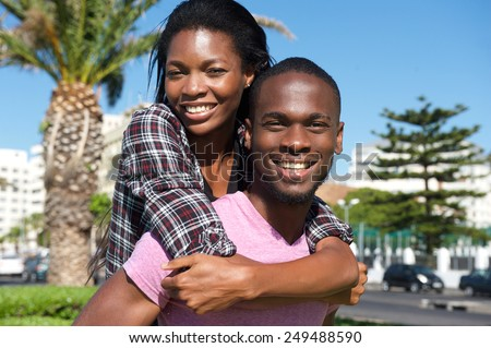 Close up portrait of a cheerful young couple enjoying summer - stock photo