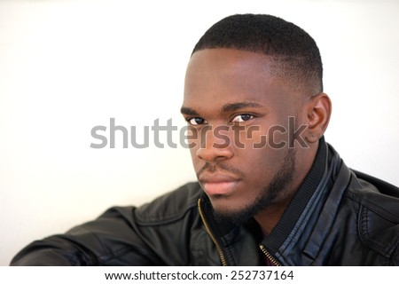 Close up portrait of a confident young african american man posing on white background