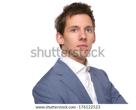 Close up portrait of a confident young man posing on isolated white background