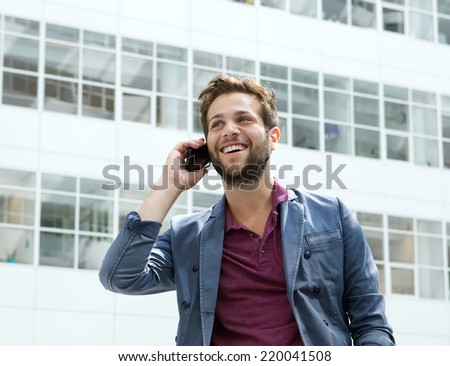 Close up portrait of a cool guy calling with cellphone - stock photo
