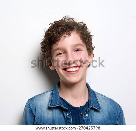 Close up portrait of a cute boy laughing on white background - stock photo