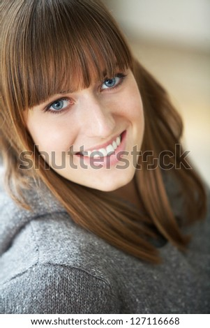 Close up portrait of a cute girl smiling - stock photo