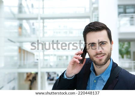 Close up portrait of a cute guy calling by mobile phone