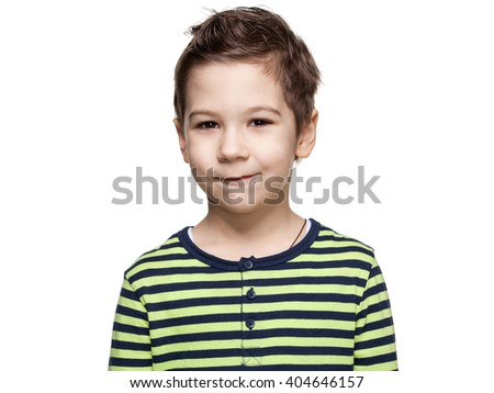 Close up portrait of a  cute little boy in a striped shirt, he is smiling, white background