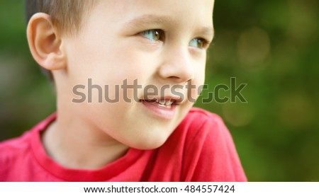 Close-up portrait of a cute little boy, outdoor shoot