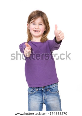 Close up portrait of a cute young girl showing approval with thumbs up hand gesture - stock photo