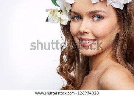 Close-up portrait of a fair-skin beauty isolated on white