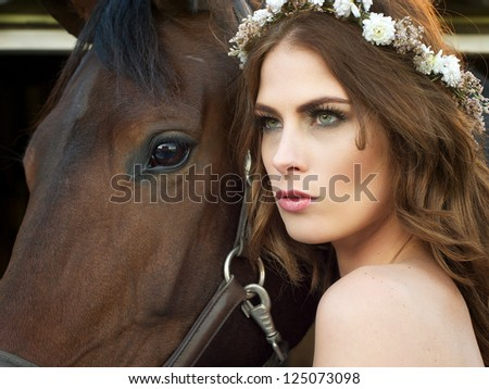 Close up portrait of a fashion bride with horse - stock photo