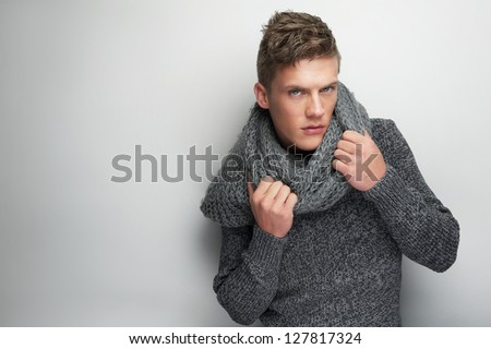 Close up portrait of a fashion model holding scarf - stock photo