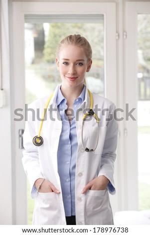 Close-up portrait of a female doctor standing in clinic. - stock photo