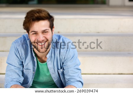 Close up portrait of a friendly young man smiling  - stock photo